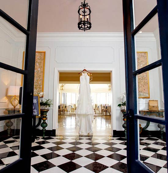 Wedding gown viewed through French doors